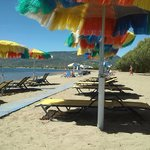 A private beach with Hawaian umbrellas