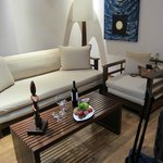 The living room area of our suite with a complimentary bowl of fruit and a bottle of wine!
