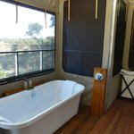 Large bathroom with bath and outdoor shower