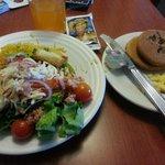 Dinner.  Cordon Bleu, corn bread, salad, yellow rice, peanut butter & chocolate chip cookies.