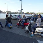 Classic and modern Vespa, waiting for the ferry