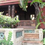 one of the actual teak houses in the compound.