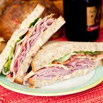 Ham & Smokey Cheese with smoked gouda, ham, lettuce, tomato, red onion & chipotle sauce on Sourd