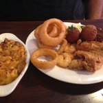 Seafood platter with onion rings & macaroni on side