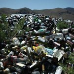 """Glass bottle mountain found on site. Yet signs posted advise that visitors """"Leave No Trace."""" Iro"""