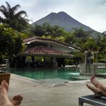poolside view of volcano on a clear day