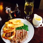 Yummy sirloin steak accompanied by a Staffordshire blue cheese sauce