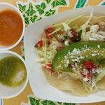 Tiny tortilla fish taco with 2 sauces