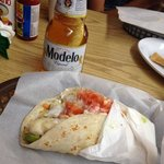 Yummy fish taco with a super cold beer!