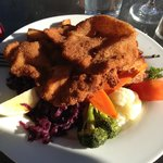 Awesome home cooking! Wiener schnitzel, purple cabbage, roasted potatoes and cooked veggies.