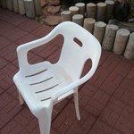 dirty plastic Walmart patio chair.