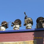 Little TIN MEN on Roof Top in small village