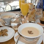 Homemade granola, celery root soup with duck, mimosas