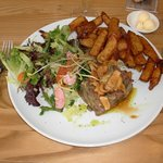 Venison tartar with French fries and salad