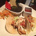 Grilled chicken tacos with black beans.