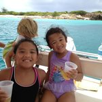 Kids get into the captain's seat and enjoy some drinks and snacks while the adults go snorkeling