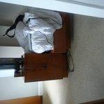 Side shot of bedroom. Door frame impedes entering room with wheelchair.