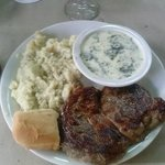 Delicious Delmonico beef with mashed potatoes and creamed spinach
