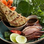 Half crisp skin roasted duck with hoisin, green onion pancake and pickled cucumber