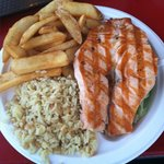 Delicious salmon, rice pilaf, fries
