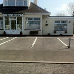 Guest house frontage and parking.