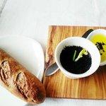 bread with olive oil, black salt and butter, black olive powder