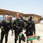 Left to right Divemaster  Mo, son George and Instructor Ashraf after a training dive