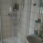 older shower, tight squeeze, no shampoos or soaps