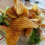 Homemade chips atop turkey club