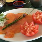 A delicious breakfast of smoked salmon, tomatoes, and herbs