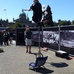 Street performer on a unicycle juggling knives