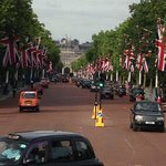 In front of Buckingham Palace love the street lined with flags!