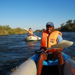 Canoeing to breakfast on the Zambezi at Royal Chundu