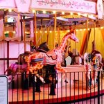 the colorful carousel,with whimsical characters