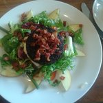 Black pudding with bacon bits salad