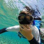 Sawyer loving the beautiful water of Ambergris Caye
