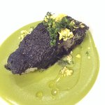 Baby turbot with black olive lifejacket swimming in French pea puree