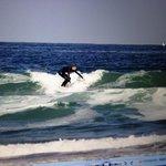 Son surfing in Blacks Beach