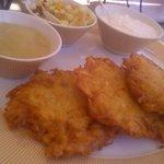 Latkes, fruit salad, cream and apple compote