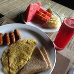 american breakfast with fruit platter and watermelon juice. You also get bacon with your eggs
