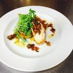 Chicken breast stuffed with sun blushed tomato pesto, bocconcini, polenta, warm puttanesca style