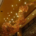 glass dragon on ceiling of lobby of hotel