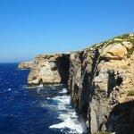 Walk along cliff top by El Milenea window