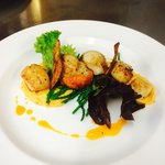 Pan fried scallops, butternut squash purée, samphire grass finished with a chilli and lemon gras