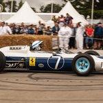 John Surtees makes a run up the hill