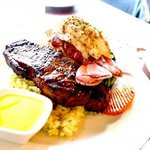 well-done New York steak with lobster tail