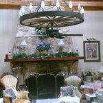 wagon wheel chandelier & stone fireplace