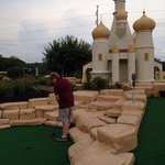 My youngest on the mini golf course!