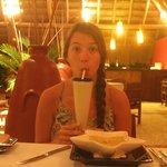 Nellie enjoying her pina colada at dinner.