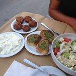 tzatiki dip , cheese zucini balls, garlic toast and a greek salad
